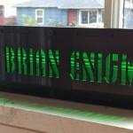 A laser-cut light-up nameplate