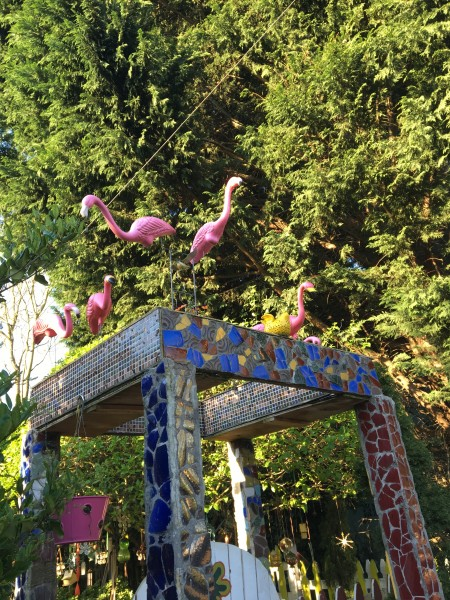 Pink flamingos on a tiled arch, of course.